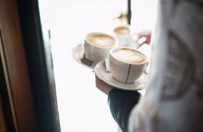 ep archivo   un camarero sirve varios cafes en una cafeteria de vitoria el sector servicios saca a