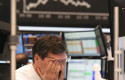 ep main a stock trader rubs his eyes on the floor of the frankfurt stock exchange stock exchanges